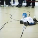 Budapest, 2014. január 11. Robotautó halad a műszaki egyetemen immár ötödik alkalommal megrendezett RobonAUT versenyen 2014. január 11-én. A mesterszakos mérnökhallgatókból álló csapatoknak olyan kisautókat kellett tervezni, amelyek emberi beavatkozás nélkül képesek végighaladni az akadálypályán. MTI Fotó: Koszticsák Szilárd