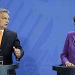 Angela Merkel német kancellár (j) és Orbán Viktor miniszterelnök sajtótájékoztatót tart a berlini kancellári hivatalban 2014. május 8-án. (MTI/AP/Michael Sohn)