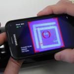 A SMark (Secure Mark) biztonsági címkét leolvasó okostelefonos alkalmazás egy miskolci kísérleti üzemben 2015. március 5-én. A világon eddig sehol nem alkalmazott, magyar tudósok által kifejlesztett termékazonosító technológia egy olyan biztonsági címke, amelynek használatával az eredetiség kétség nélkül azonosítható. MTI Fotó: Vajda János