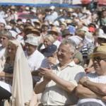 Semjén Zsolt nemzetpolitikáért felelős miniszterelnök-helyettes (j2) a résztvevők között Orbán Viktor miniszterelnök beszéde közben a 26. Bálványosi Nyári Szabadegyetem és Diáktáborban (Tusványos) az erdélyi Tusnádfürdőn 2015. július 25-én. MTI Fotó: Koszticsák Szilárd