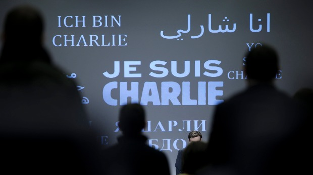 "epa04550746 "" Je suis Charlie"" in several languages during  minute of silence in the main press room of the European commission at the start of the midday Press briefing in Brussels, Belgium, 08 January 2015 in solidarity with those killed in the shooting of 12 people at the satirical magazine Charlie Hebdo. At least 12 people were killed 07 January 2015 in a terrorist attack against satirical French magazine 'Charlie Hebdo' in Paris.  EPA/OLIVIER HOSLET"