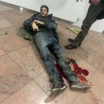 A grúz közszolgálati média által közreadott és Ketevan Kardava által készített kép egy sebesült férfiről a brüsszeli Zaventem nemzetközi repülőtéren, miután kettős robbantás történt 2016. március 22-én. (MTI/AP/Grúz közszolgálati média/Ketevan Kardava)