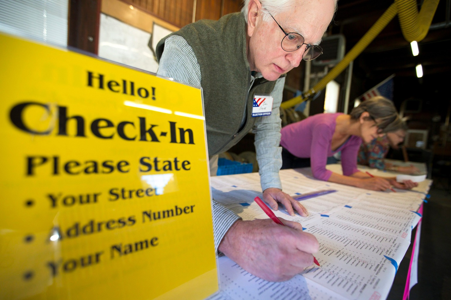 epa05623005 Poll workers William Stone and Nonie Valentine check voters in at the Lexington Avenue Fire House in Cambridge, Massachusetts, USA, 08 November 2016. Americans vote on Election Day to choose the 45th President of the United States of America to serve from 2017 through 2020. EPA/LISA HORNAK
