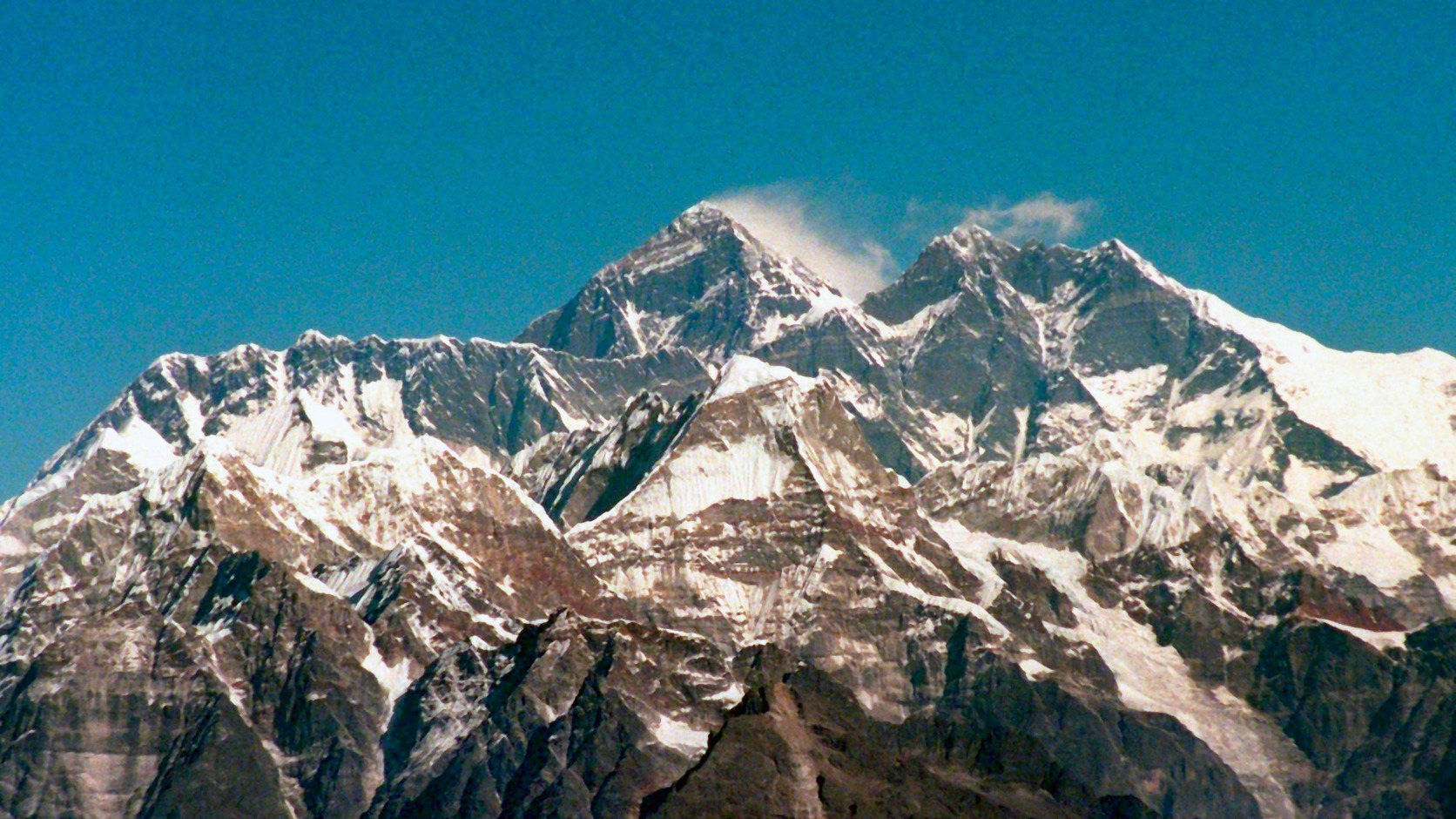 epa05981343 (FILE) - A file picture dated 29 November 1996 showing the Himalya range and Mount Everest, the highest mountain on earth (C) from an airplane in Nepal. Accoding to reports from 22 May 2017, the Hillary Step on Mount Everest collapsed. The 12-metres outcrop was the last obstacle on the way to Mount Everest's peak.  EPA/MARTIN ATHENSTAEDT  GERMANY OUT