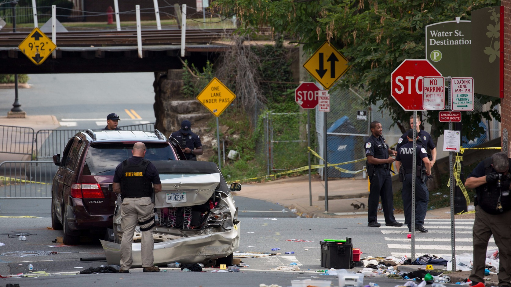epa06141385 Virginia State Police inspect the site where a vehicle hit protesters in Charlottesville, Virginia, USA, 12 August 2017. According to media reports at least one person was killed and 19 injured after a car hit a crowd of people counter-protesting the 'Unite the Right' rally which was scheduled to take place in Charlottesville on 12 August. At least 15 others were injured in clashes during protests.  EPA/TASOS KATOPODIS