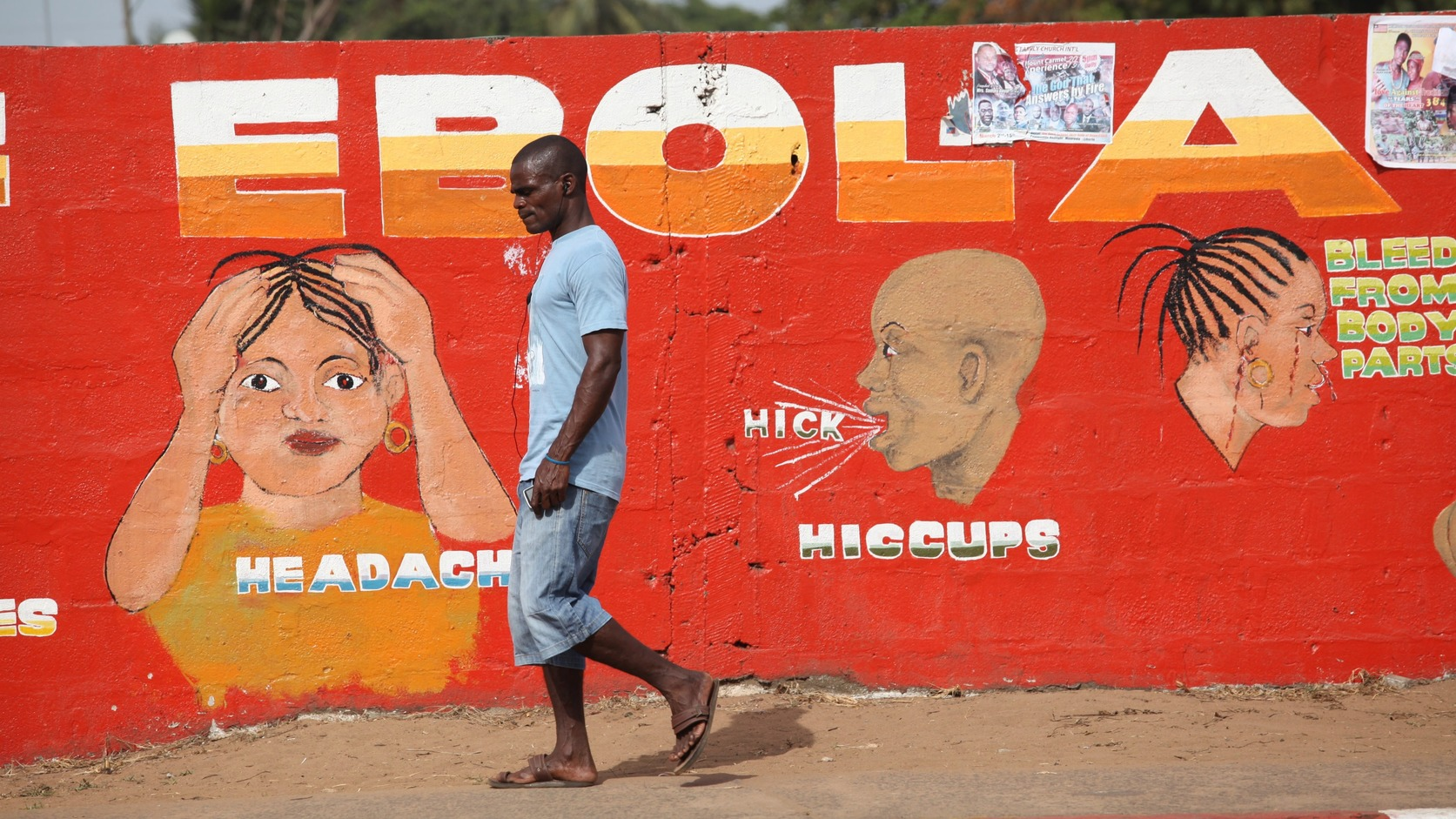 epa06727348 (FILE) - A Liberian man walk pass an ebola awareness painting on a wall in downtown Monrovia, Liberia, 22 March 2015 (reissued 11 May 2018). The World Health Organization (WHO) on 10 May 2018 said that 32 Ebola virus disease cases, including 18 deaths, were reported from Bikoro health zone, Equateur province, Democratic Republic of the Congo, of which were two confirmed, 18 probable and 12 suspected cases.  EPA/AHMED JALLANZO