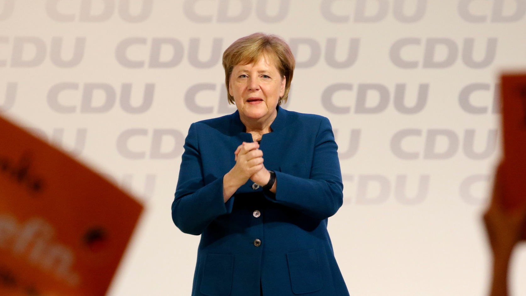 epa07214433 German Chancellor Angela Merkel gestures at the end of her speech during the 31st Party Congress of the Christian Democratic Union (CDU) in Hamburg, Germany, 07 December 2018. At the party congress, a new party leader is to be elected. Associated with the new party leader is the debate over the fundamental political orientation of the CDU after Chancellor Merkel will no longer hold this office.  EPA/FOCKE STRANGMANN