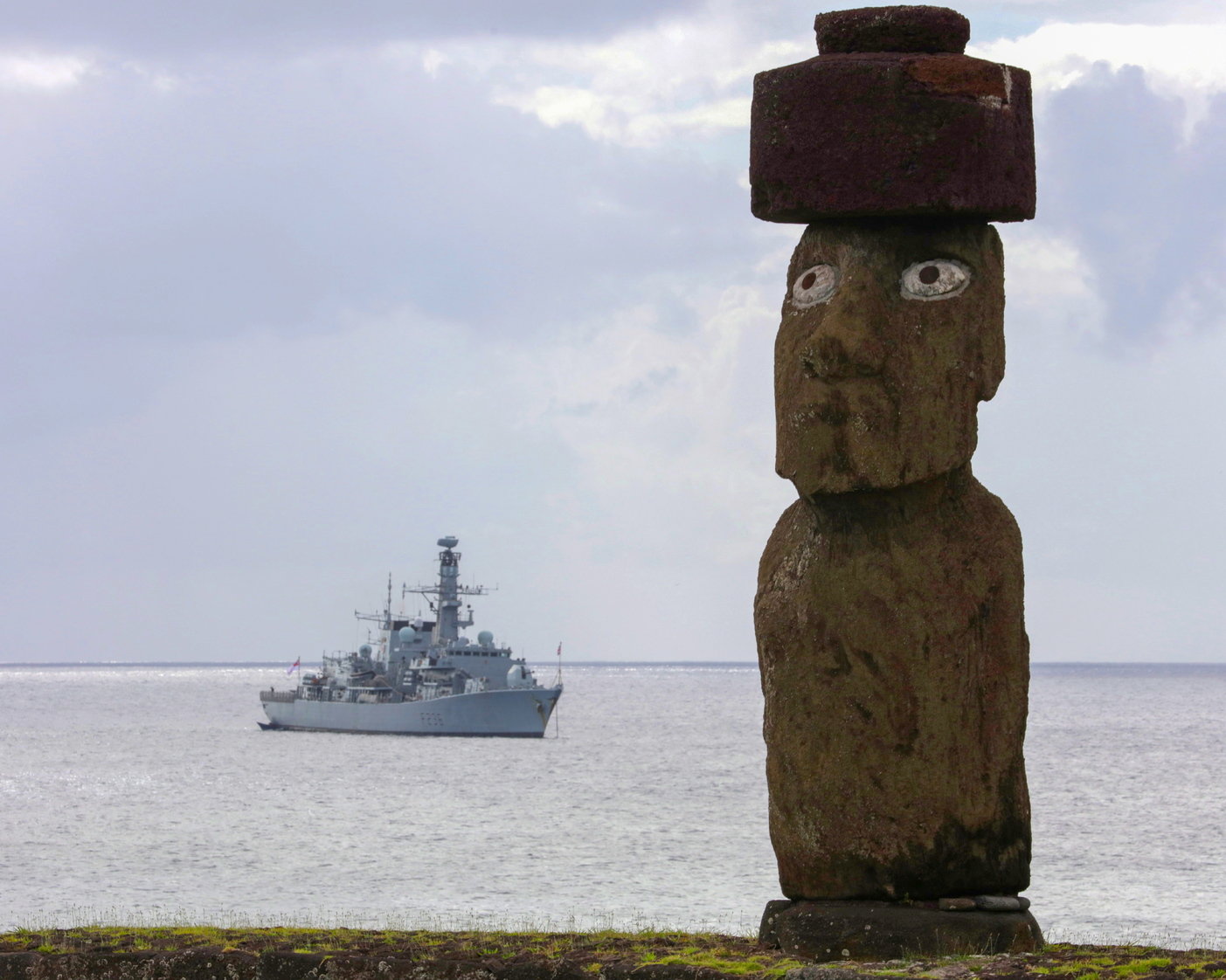 epa07251792 A handout picture provided by the British Ministry of Defence showing a Lone Moai (stone statue) on Easter Island with British Royal Navy, Type 23 frigate, HMS Montrose behind in the sea on 27 December 2018, (issued 28 December 2018). The British MOD reported that HMS Montrose visited one of the wonders of the world which is Easter Island otherwise known as Rapa Nui, home of the famous Moai, huge stone statues that where made hundreds of years ago by the ancestors that lived on the island. There's 1000 Moai on the island. HMS Montrose is currently deployed on a global deployment where it's visiting many countries on the way to Bahrain. She is currently two month in to a seven month deployment.  EPA/LPhot JOE CARTER /BRITISH MINISTRY OF DEFENCE/HANDOUT MANDATORY CREDIT: MOD - JOE CARTER /CROWN COPYRIGHT HANDOUT EDITORIAL USE ONLY/NO SALES