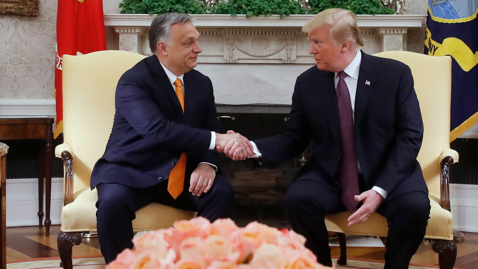epa07568180 US President Donald J. Trump (R) and Hungarian Prime Minister Viktor Orban shake hands during their meeting in the Oval Office of the White House in Washington, DC, USA, 13 May 2019.  EPA/Szilard Koszticsak HUNGARY OUT